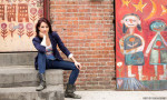 Abby Martin in front of murals.