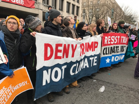 Climate protesters blocking the gate at 3rd and Indiana Avenue NW. (Justin Jouvenal for The Washington Post)