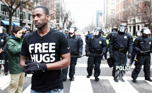 Free Hugs with militarized police at Trump inauguration protest by Eleanor Goldfield for Art Killing Apathy