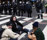 Militarized police and card players sit-in from Trump Inauguration protests by Eleanor Goldfield, Art Killing Apathy