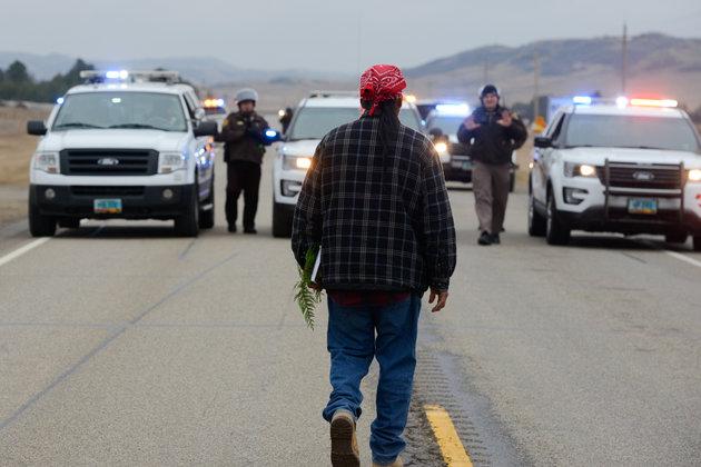 A protester blocks highway 1806 in Mandan during a protest against plans to pass the Dakota Access pipeline near the Standing Rock Indian Reservation, North Dakota, U.S. November 23, 2016. REUTERS/Stephanie Keith