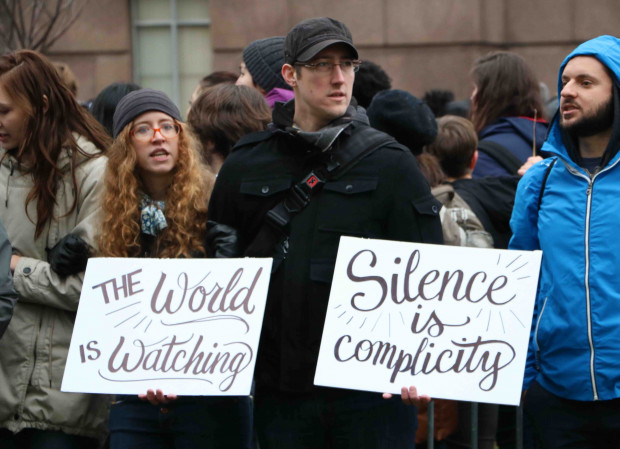 Silence is complicity, The World is Watching, Trump Inauguration protest by Eleanor Goldfield for Art Killing Apathy