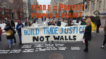 Trade Justice Not Wall protest on Inauguration Day defines what trade justice requires knowing Trump was withdrawing from TPP. Our battle now is making trade that protects people and planet. Photo: Popular Resistance.