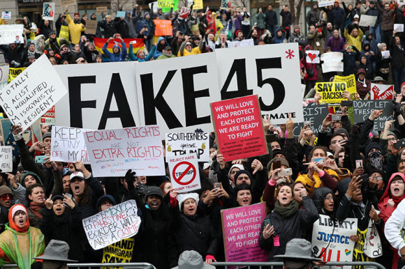 Trump protesters on Inauguration parade route on Pennsylvania Ave. at Navy Memorial Plaza. Source NY Times.