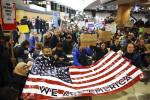 Protesters occupy part of Seattle-Tacoma International Airport, to demonstrate against President Trump's executive order restricting immigration refugees. Associated Press / Associated Press