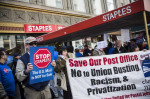 Unionized Postal Service workers protest outside a New York Staples store in 2014. (Andrew Burton/Getty Images)