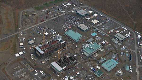 Construction of the massive Hanford site is shown in 2013. The cost of completing the plant to treat radioactive waste now stands at $16.8 billion. (U.S. Department of Energy)