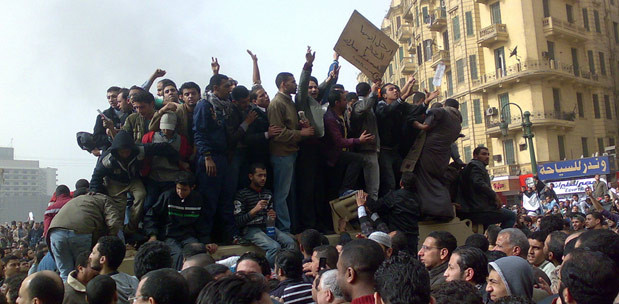 Protesters on top of a tank in Tahrir Square, Cairo, Egypt, January 29, 2011 (Ramy Raoof / Flickr)