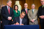 House Speaker John Boehner (R-Ohio) signs the Keystone XL Pipeline bill during a ceremony on Capitol Hill in Washington, February 13, 2015. The bill was sent to President Obama, who vetoed it. (Jabin Botsford/The New York Times).