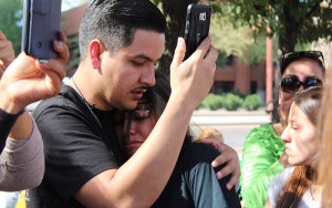 Aarón Rayos and his daughter, Jacqueline, 14, comfort each other after hearing her mother has been deported. by Chgarlene Santiago for Cronkite News.