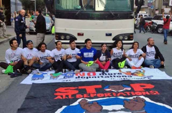 Youth block the front of deportation bus in San Francisco. Source National Day Laborer Organizing Network