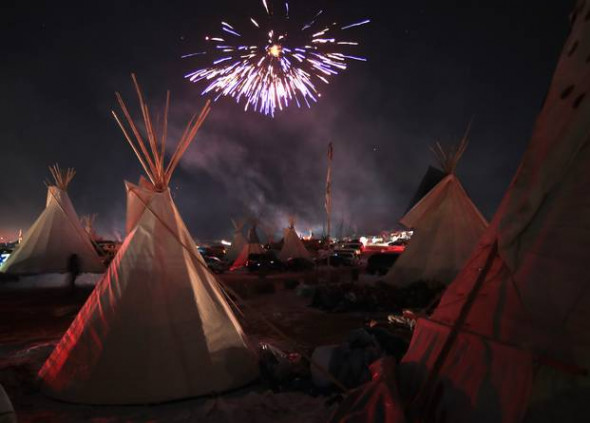 Fireworks over Oceti Sakowin on Dec. 4, 2016 as demonstrators celebrate the decision to effectively halt construction on the Dakota Access Pipeline.Source: Scott Olson/Getty Images