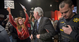 Roseville police escort Rep. Tom McClintock through an audience froma town hall meeting in California on Feb. 4. AP Photo