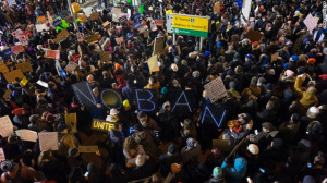 Protesters at John F. Kennedy International Airport in New York protest Trump immigration order.