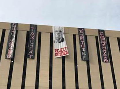 Puzder banner drop