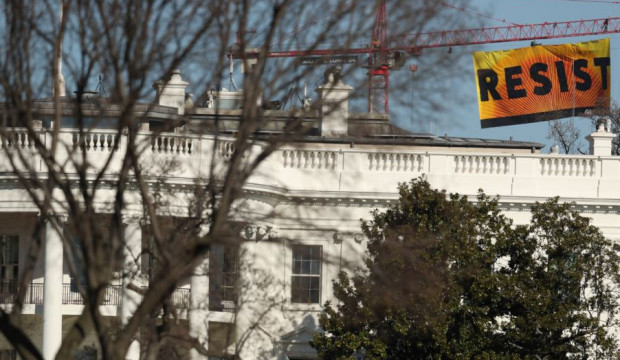 Resist banner flies over the Donald Trump White House by Greenpeace.