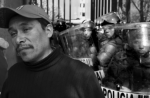 A striking teacher from Michoacán demonstrates in Mexico City in front of a line of police. Canadian and US teachers have organized the TriNational Coalition to Defend Public Education to support Mexican teachers' efforts to defeat proposals to introduce standardized testing and remove job protections, which have come from USAID and private foundations promoting corporate education reform. (David Bacon)