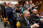 AP Photo/Pablo Martinez Monsivais File photo: Apple co-founder Steve Wozniak, left, stands up and joins others in the audience in applauding the Federal Communications Commission (FCC) vote in 2015 to approve net neutrality rules.