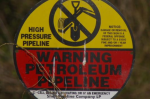 A pipeline warning sign in Louisiana. (Photo by ilouque via Flickr.)