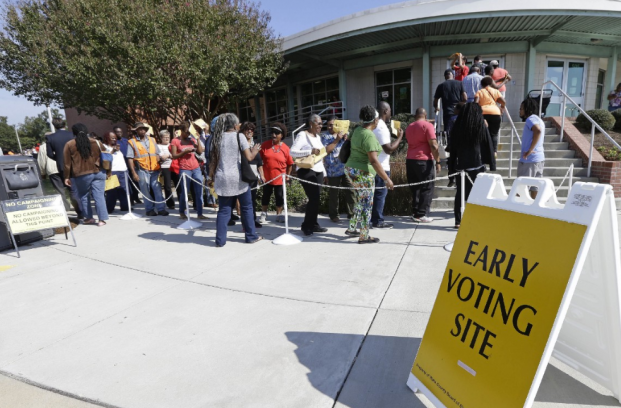 Voters line up during early voting in Raleigh, N.C. Fourteen states had new voting or registration restrictions in place for the 2016 presidential election, raising concerns that minority voters in particular would have a harder time accessing the ballot box. CREDIT: AP Photo/Gerry Broome