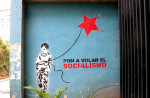 Wall mural urging put socialism to flight.