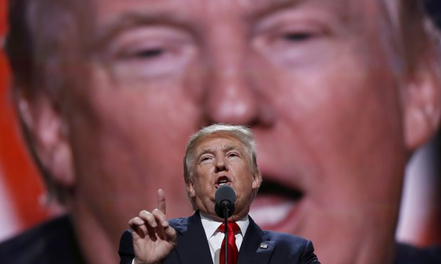 Trump speaking in front of a picture of his own face at the Republican National Convention in July 2016. Photograph Carolyn Kaster-AP