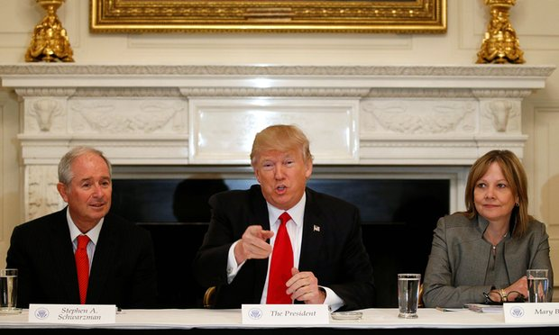 Trump flanked by the Blackstone CEO, Stephen Schwarzman, a Momentive investor and Trump's 'jobs czar', and the General Motors CEO, Mary Barra. Photograph: Kevin Lamarque/Reuters