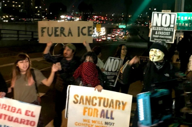 Protesters shut down an intersection near an ICE detention facility in Los Angeles, California late Thursday. (Photo: NDLON/Twitter)