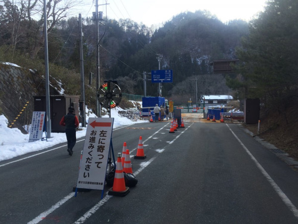 Blue guardhouse checkpoint on highly contaminated road. Guardhouse is lined with lead to protect the guard.