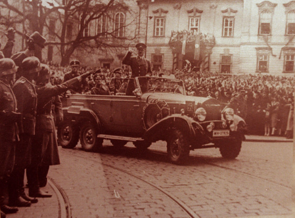 Adolph Hitler waves to crowds in his six-seater Mercedes car in this undated World War II file photo. Handout