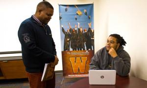 Autre Murray speaks with Ron Dillard, director of the Western Michigan University's Kalamazoo Promise Scholars Program. Photo by J. Gabriel Ware.