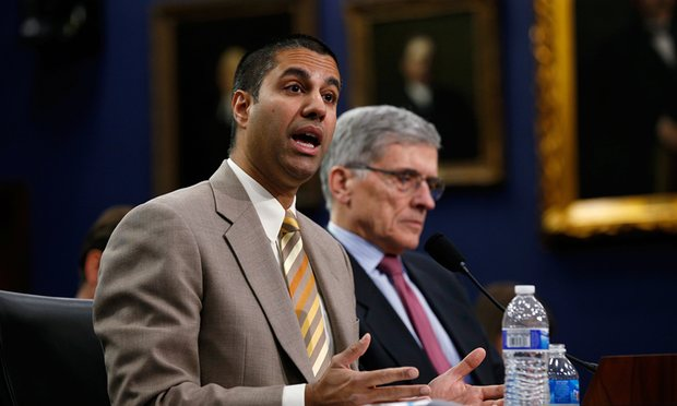 Ajit Pai (left), Trump's appointment as the new Federal Communications Commission chairman, with Tom Wheeler, the Democrat he replaced. Photograph: Kevin Lamarque/Reuters