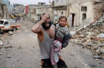 Mosul destruction father and daughter crying. All photos from Iraq Over the Red Line Group March 2017