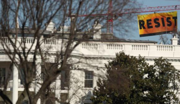 Resist-Greenpeace-banner-over-White-House-2017-e1486859588919
