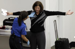 A woman undergoes a pat-down during TSA security screening Nov. 19, 2010, at Seattle-Tacoma International Airport. (Ted S. Warren / Associated Press)