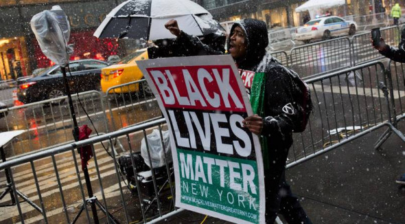 A Black Lives Matter supporter demonstrate outside of Trump Tower in New York City.Source: Dominick Reuter/Getty Images
