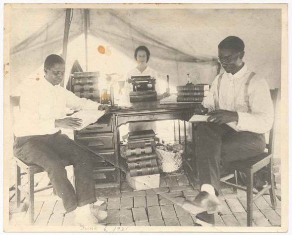 Practicing law in a Red Cross tent are B.C. Franklin (right) and his partner I.H. Spears with their secretary Effie Thompson on June 6, 1921, five days after the massacre. (NMAAHC, Gift from Tulsa Friends and John W. and Karen R. Franklin) Read more: http://www.smithsonianmag.com/smithsonian-institution/long-lost-manuscript-contains-searing-eyewitness-account-tulsa-race-massacre-1921-180959251/#8axZlEhCRMOUD9TU.99 Give the gift of Smithsonian magazine for only $12! http://bit.ly/1cGUiGv Follow us: @SmithsonianMag on Twitter