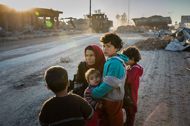 A family who fled their home in Mamun, a neighborhood in Mosul, Iraq, March 9, 2017. A US airstrike in Mosul last month killed more than 200 people, causing the largest loss of civilian life since the United States began bombing ISIS in Syria and Iraq in 2014. (Photo: Ivor Prickett / The New York Times)