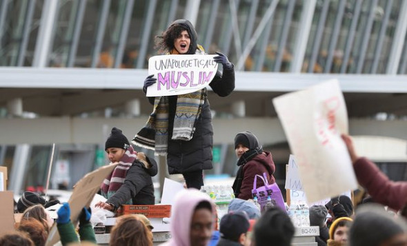 Protesters against Trump's travel ban order outside JFK Airport, 30 January. Photograph: Xinhua / Barcroft Images