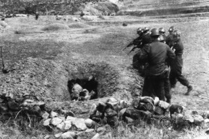 Bodo League Massacre, South Korean troops shoot political prisoners near Daegu, South Korea in April 1951. (AP-National Archives-U.S. Army)