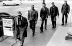 "March 30, 1955 Off to Jail Again -- Minnesota's four Doty brothers surrendered Tuesday to the United States marshal in St. Paul to begin a second prison term for their defiance of military conscription. Above, they are leaving the federal courthouse on their way to Ramsey county jail, accompanied by their father, William (far left), a Bruno, Minn., farmer, who served a World War I prison term for his pacifist beliefs. The brothers, all sentenced to two years, are (left to right Joel. 28, Orin, 27, Paul, 26, and Sid, 25. Their jailward journey ironically took them past a United States air force recruiting sign outside the courthouse. Joel, spokesman for the brothers, handed reporters a handwritten statement reaffirming their belief that ""conscription and war is wrong"" and declaring that ""we feel that we are going back to prison for the second time for the same offense"". March 29, 1955 Larry Schreiber, Minneapolis Star Tribune"