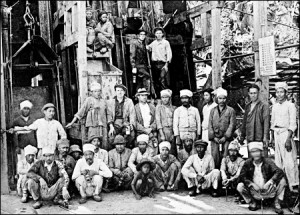 Miners and foreign workers pose together at the American-owned Oriental Consolidated Mining Company (OCMC) in Unsan in this undated photo. Korean gold miners believed in the mountain spirit. / Robert Neff collection
