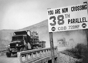 Military vehicles crossing the 38th parallel during the Korean War. NARA