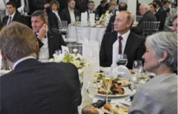 Green Party leader Jill Stein and retired Lt. General Michael Flynn attending a dinner marking the RT network's tenth anniversary in Moscow, December 2015, sitting at the same table as Russian President Vladimir Putin.
