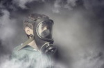 Child wearing a gas mask against air pollution Photo Credit: xef/Shutterstock