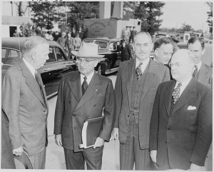 President Truman with Secretary of Defense George C. Marshall, Secretary of State Dean Acheson, and Secretary of the Treasury John Snyder, upon the President's return from the Wake Island Conference.