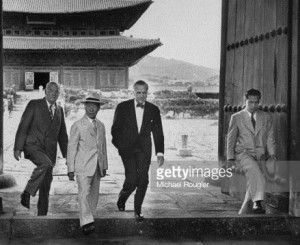 Under Secy. State Walter S. Robertson (R) with John Foster Dulles (L), escorted by Syngman Rhee. Getty Images.