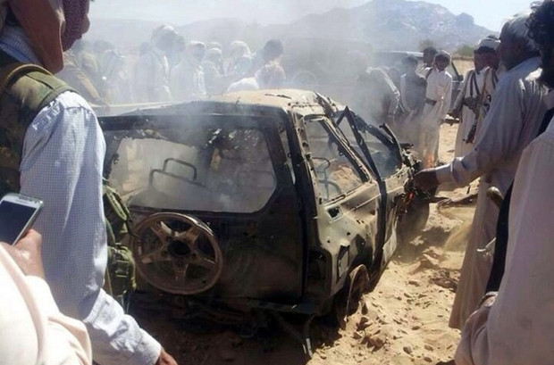 Yemenis gather around a burnt car after it was targeted by a drone strike, killing three suspected al-Qaeda militants on 26 January 2015 between the Marib and Chabwa provinces, a desert area east of Sanaa. The drone strike saw an unmanned aircraft, which only the United States operates in the region, fire four missiles at a vehicle killing the three suspected militants, a day after Washington vowed to continue its campaign against the jihadist group, despite the Arabian Peninsula country's ongoing political crisis (AFP)