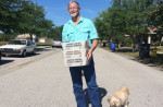 Doug Hughes, 63, holds letters to Congress he intended to deliver nearly two years ago. His dog, Rosie, is at his feet. | Ben Montgomery