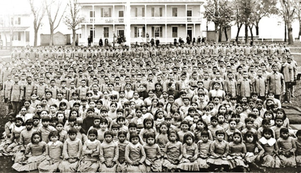 "The Carlisle Indian Industrial School in Pennsylvania (c. 1900) was one of many boarding schools sponsored by government and religious groups to ""civilize"" Indian children that had been taken from their families and communities."